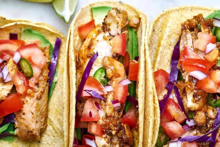 Tasty chicken tacos and crispy French fries